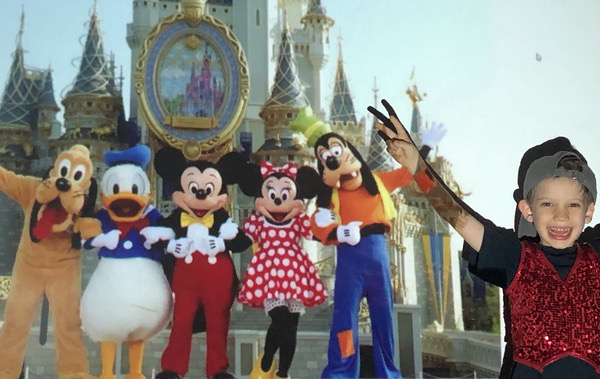 boy next to Disney characters