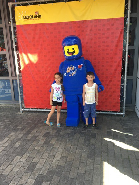Children pose with Lego character