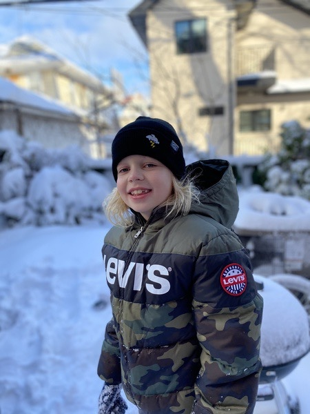 a child smiling in the snow