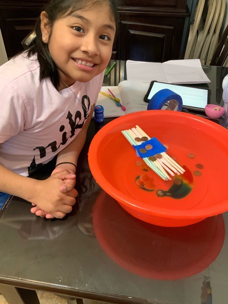 blue tape helps keep this penny boat together