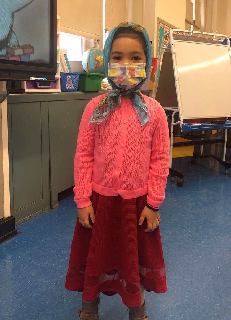 Kindergarten Student wearing a head scarf and sweater