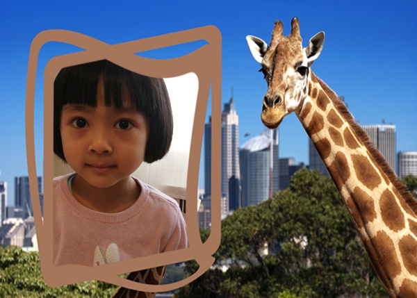 girl next to the giraffe at the zoo