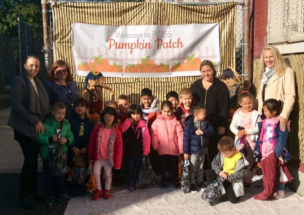 Kindergarten stands with their pumpkins at the P.S.255 Pumpkin Patch.