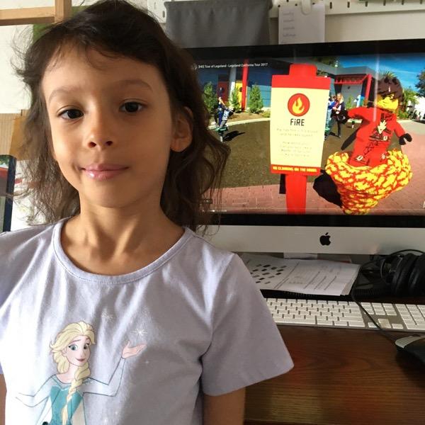 girl poses near Legoland attraction
