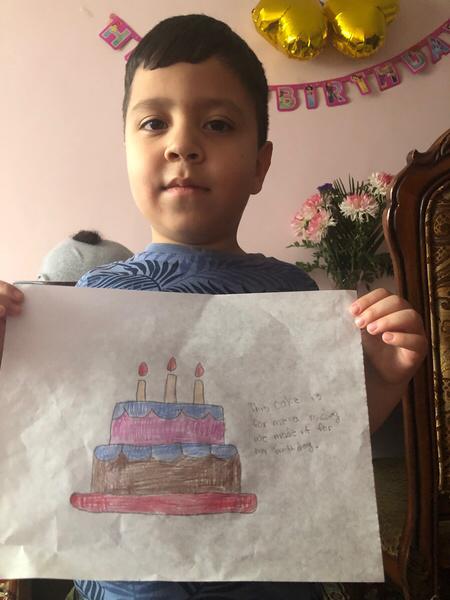 boy holding cake drawing