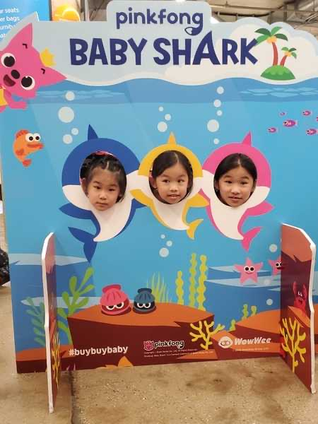 three children in baby shark cut outs