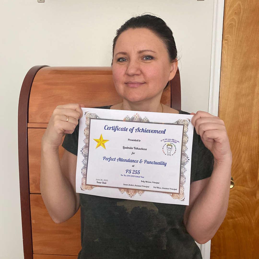 Ms. Tolkacheva holds up her attendance certificate