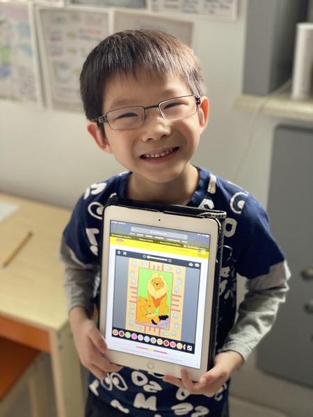 boy showing iPad work