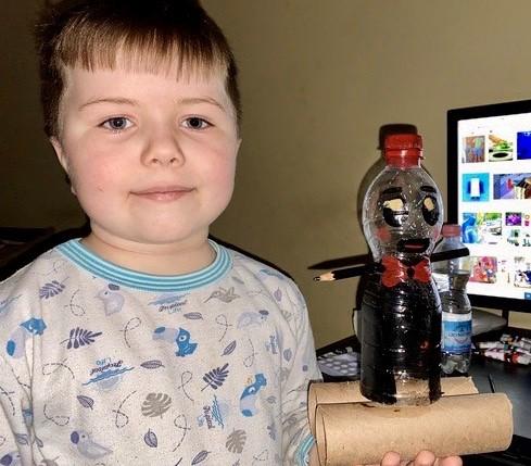 the boy built a robot using blocks