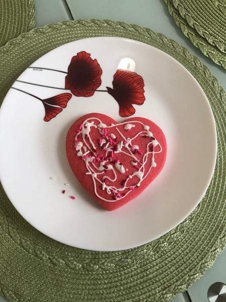pink heart cookie on a rose plate