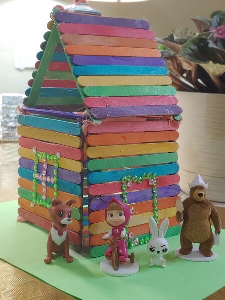 colorful house made of popsicle sticks