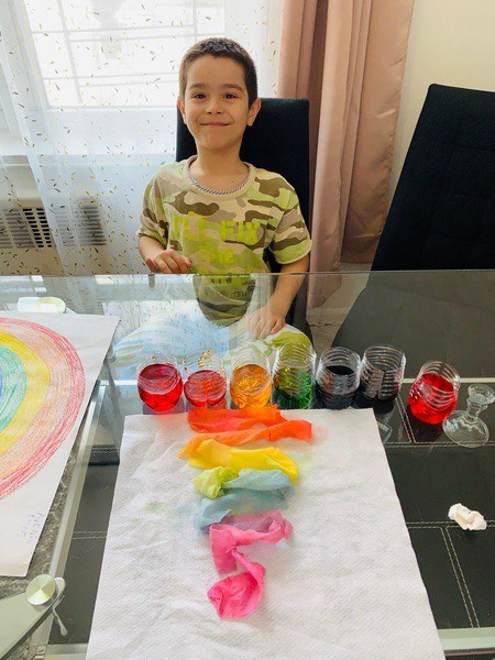 rainbow colored water on a table