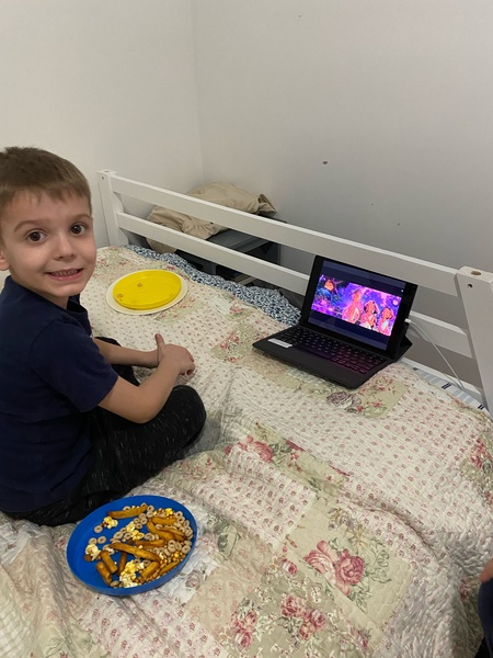 child watching a movie on ipad in bed