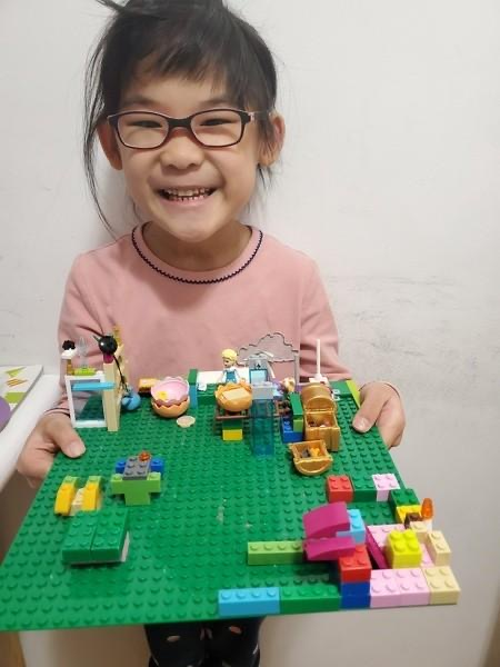 Student proudly shares her Lego creation