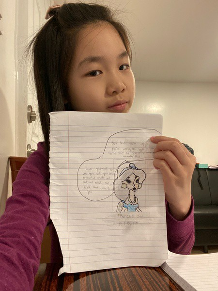 girl holds the Jasmin she drew
