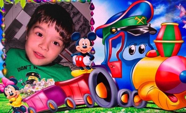 boy with mickey train