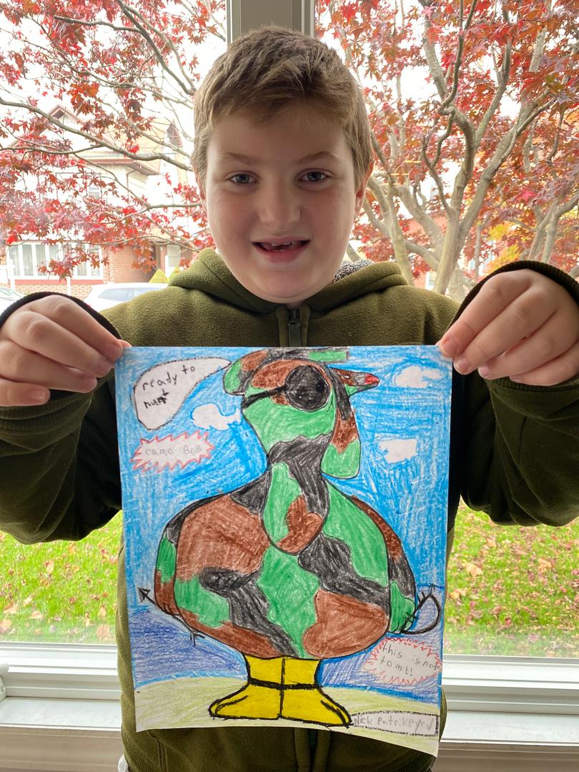 Boy holding camouflage turkey