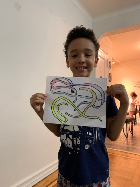 boy holds a picture of snakes