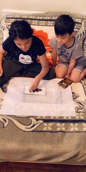 siblings work on the floor together