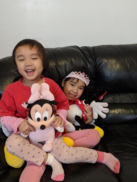 sisters with Minnie Mouse