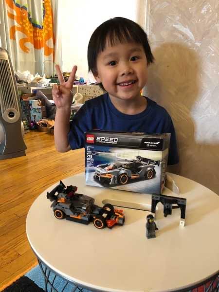 Happy boy shows his Lego car