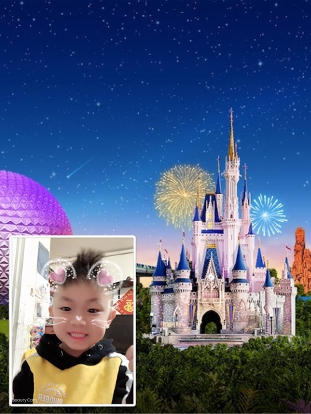 boy in frame with Disney castle
