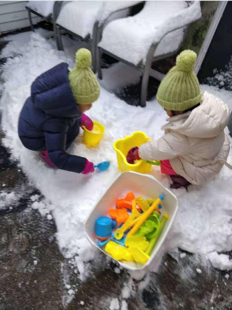 children playing with toys in the snow