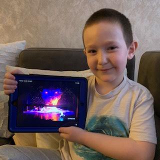 boy holds the iPad