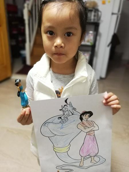 boy with Aladdin figure and artwork