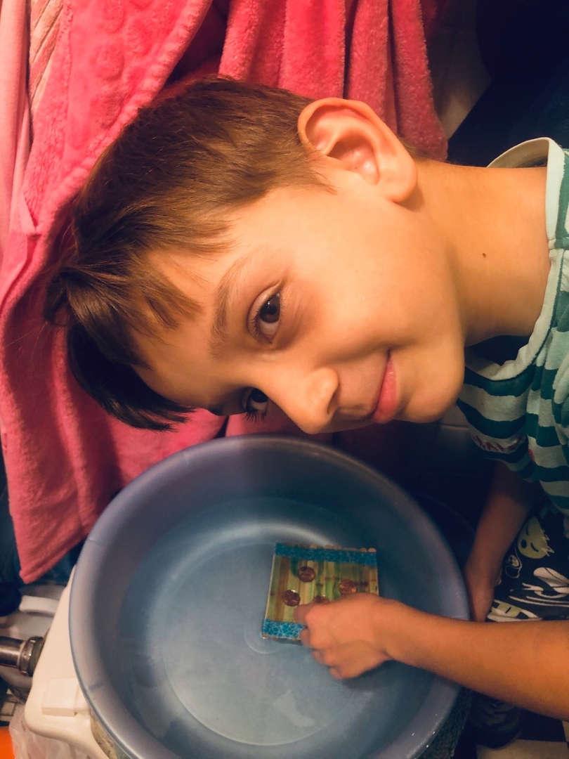boy poses next to the bowl