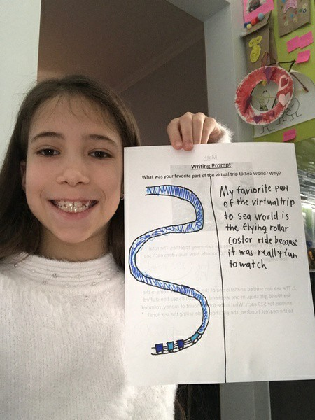 child holds T chart
