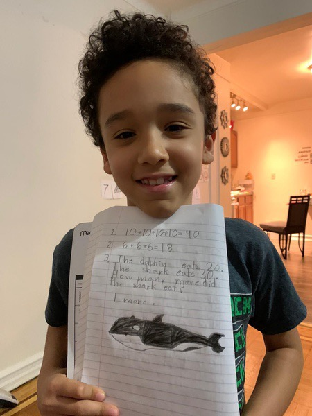 child shares his whale writing