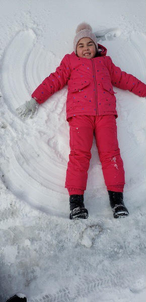 making snow angels in the cold weather