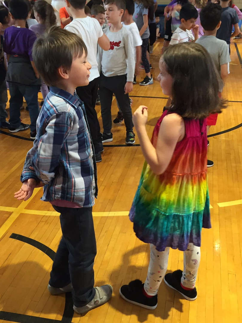 Students talk to each other during the school dance.