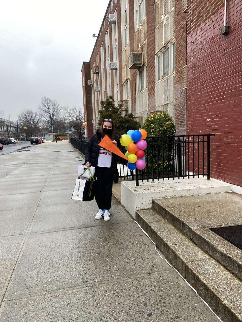 teacher holding balloons