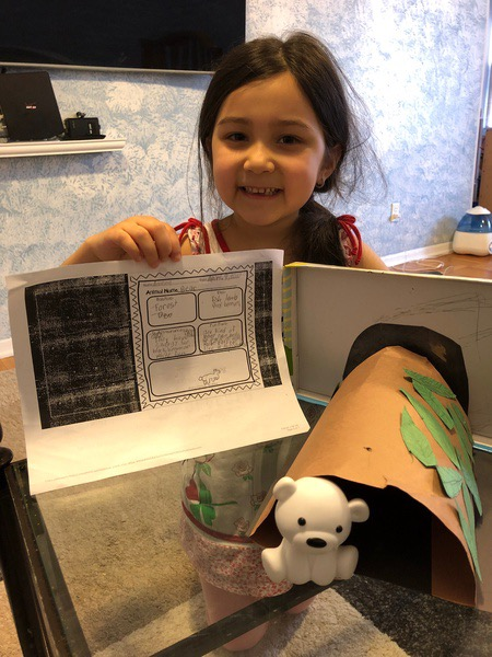 child makes a project for the zoo trip