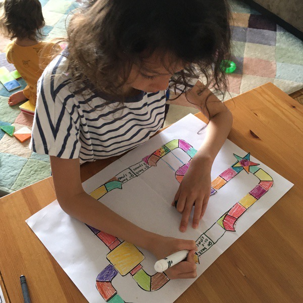 girl coloring board game pieces