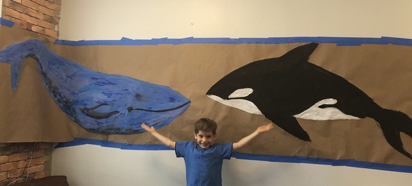 the child shares the two whales he made