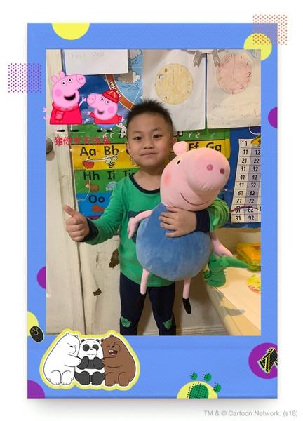 child standing holding stuffed pig