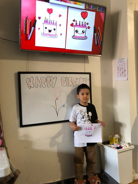 boy in front of dry erase board