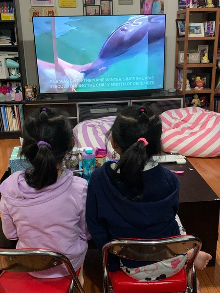 Girls enjoy their virtual trip to the Monterey Bay Aquarium