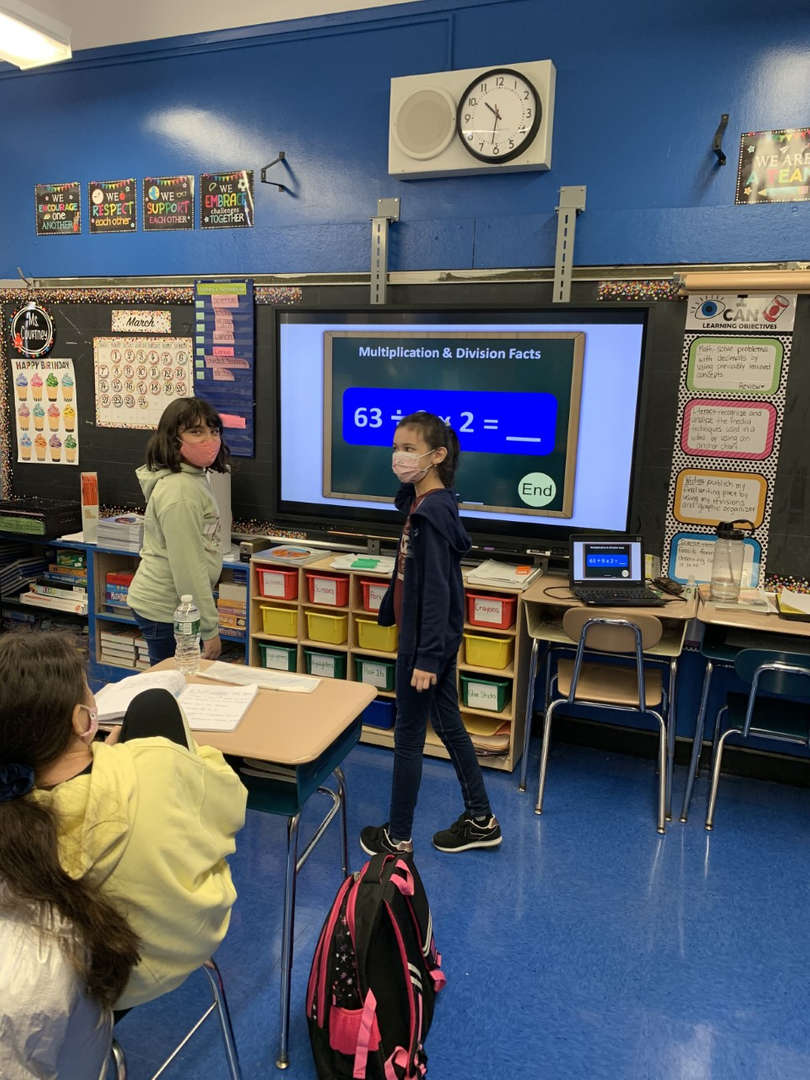 Two children competing in Math tournament