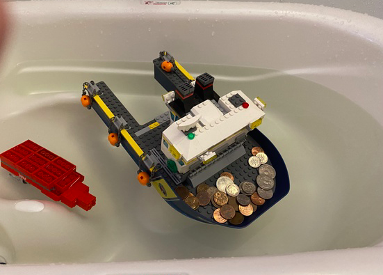 the lego boat floats with the pennies