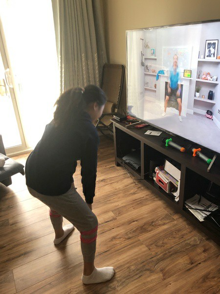 child dancing in front of tv