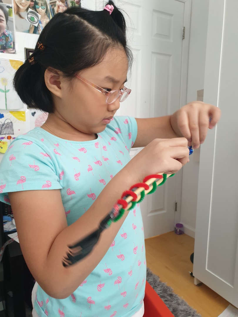 the girl works carefully on her project
