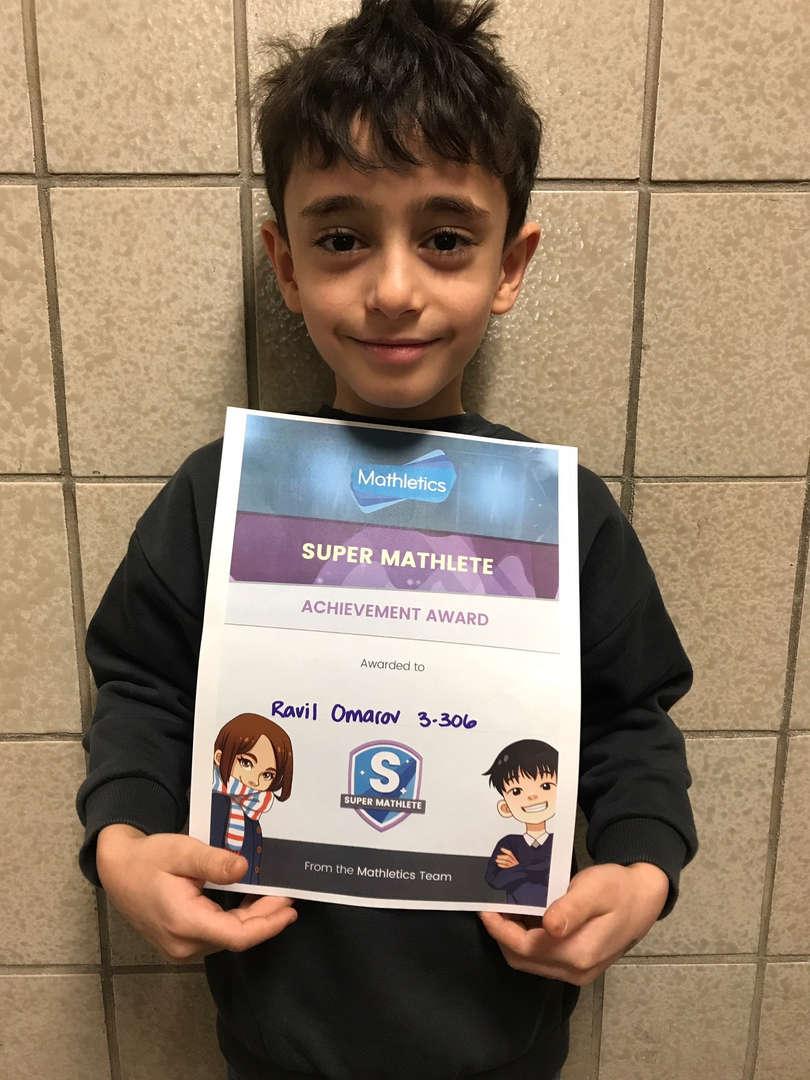 Ravil holds his Mathletics certificate.