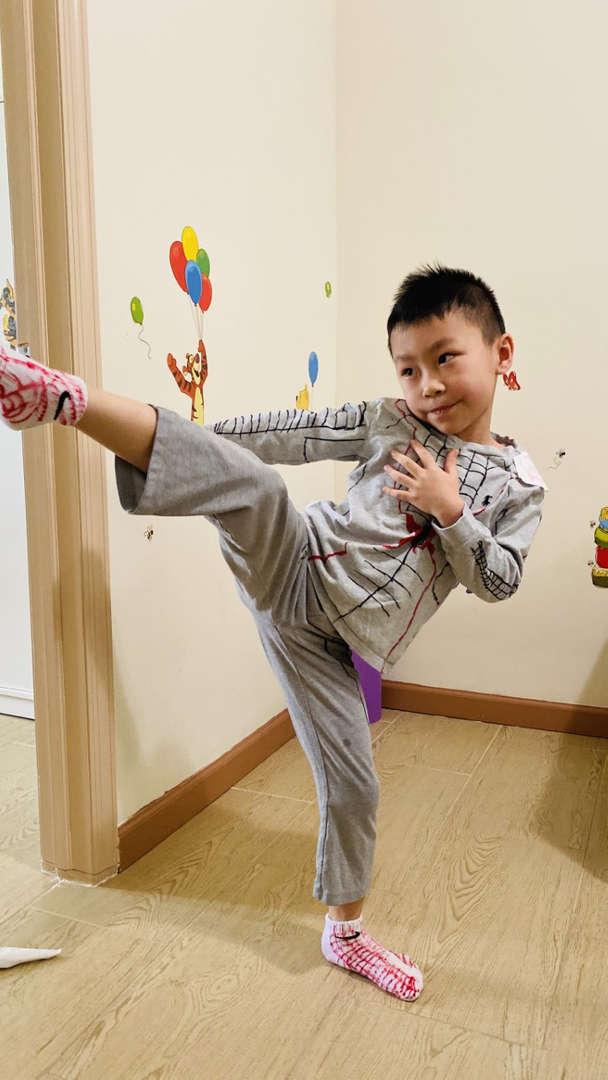 child kicks high