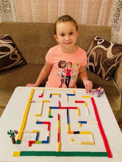 girl makes a colorful maze