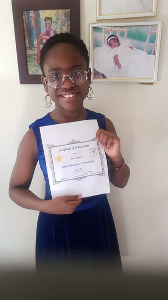 smiling girl holds her printed certificate
