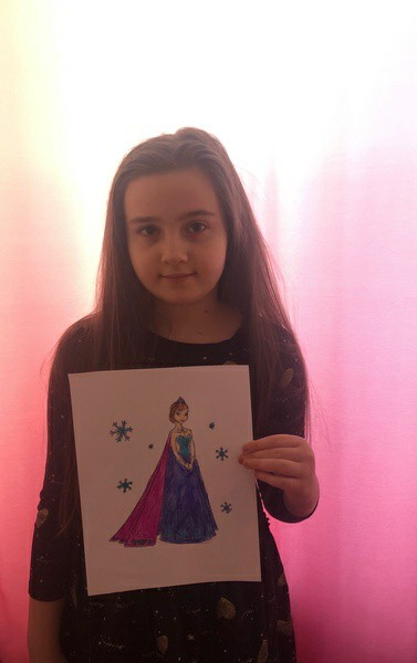 girl holds frozen picture
